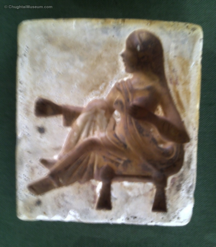 Seated woman on peeri